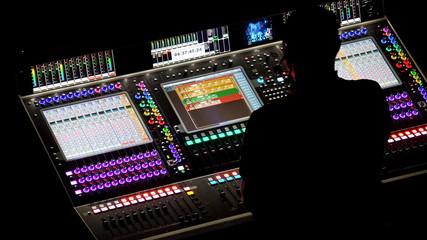 Dj at mixing console