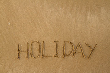 Happy Holidays Message on Beach