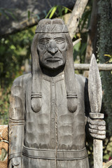 Old indians wood carving in the garden.