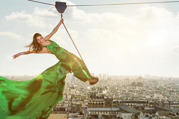 Woman on a ropeway above the city