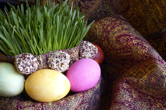 Colored eggs, wheat springs and candy on Nowruz holiday