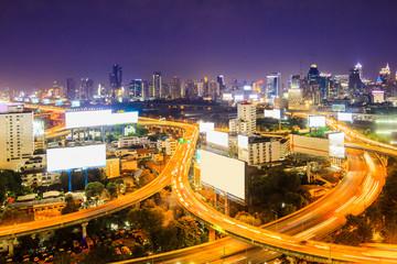 bangkok expressway with cityscape at dusk