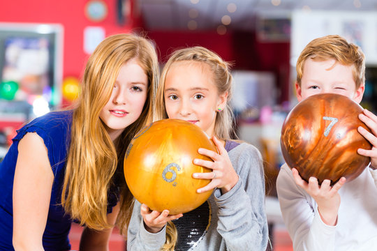 Children Friends playing together at bowling center