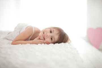 Little girl on the bed