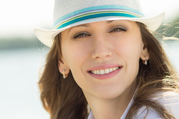 Young beautiful woman in white hat