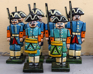 old wooden soldiers in the form of Peter I