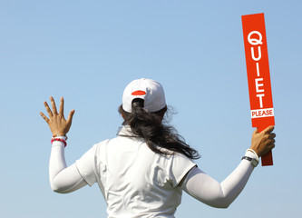 The lady volunteer shows the quite please sign in golf tournamen