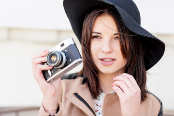 Attractive young woman talking pictures outdoor