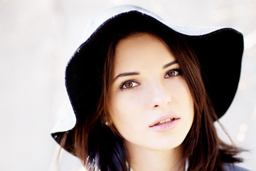 Attractive young woman in hat outdoor