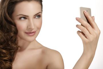 beautiful woman take a smiling selfie with smartfone
