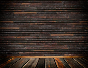 Old brickswall and wooden floor.