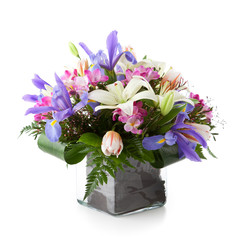 Flower arrangement made of Lily, Tulip, Iris and Freesia flowers