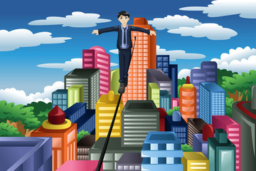 Businessman balancing on a tight rope
