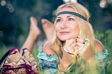 Hippie girl on a grass