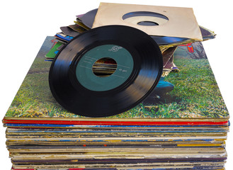 pile of 45 and 33 RPM vinyl records used and dirty even