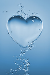 Heart made of water with bubbles on blue gradient background