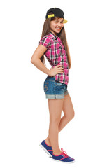Stylish girl in a cap, a shirt and shorts. Street style teenager