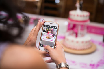 Making a photo of wedding cake from mobile phone.
