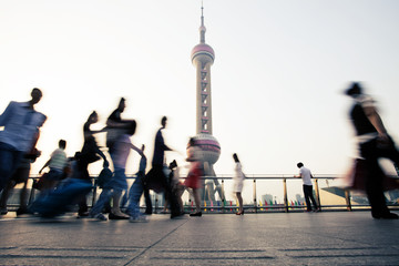 landmark and walking people in Shanghai.