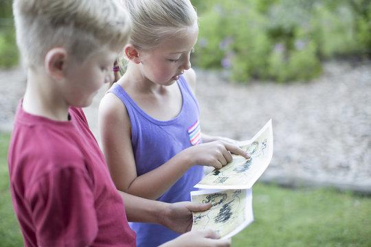Two kids on a treasure hunt