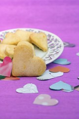Homemade heart shaped cookies with lemon sugar icing