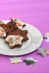 Homemade star shaped brownies with decorative icing