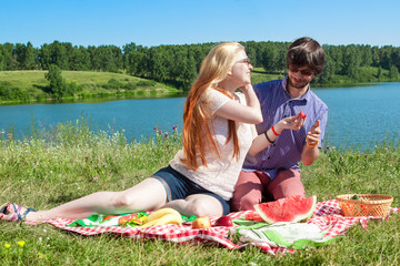 outdoor portrait of happy loving couple at the lake, which is ea