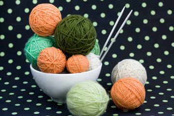 A lot of bright balls for knitting on a dark background