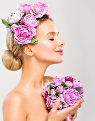 Fashion Beauty Model Girl with flowers in the hair.Perfect skin