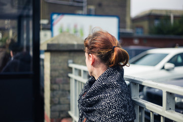 Woman waiting outside car park
