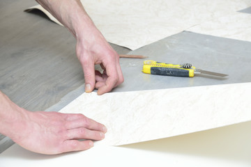 cutting and glueing wallpaper