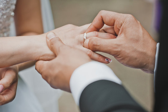 Gentle touches of hands of the newly-married couple 2051.