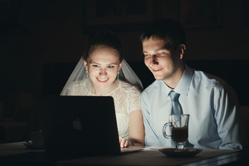 bride and groom computer