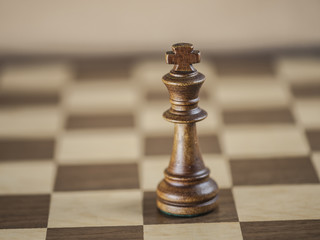 King chess piece and game board background