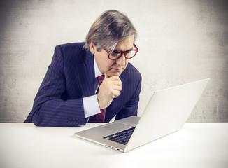 Businessman using a laptop pc