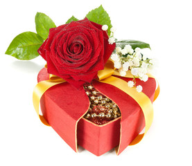 Red gift box with a rose on white
