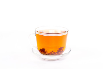 isolated transparent cup of brown tea