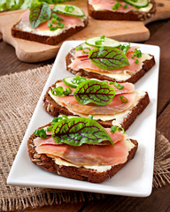 Small snacks sandwiches with salty salmon