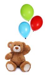 Obraz Cute teddy bear holding colorful balloons - fototapety do salonu