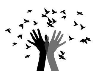 hands, releasing birds black and white