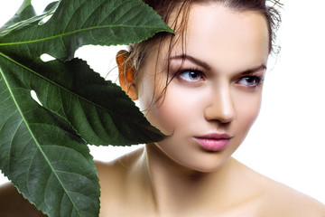 Woman with fresh tropical palm leaf. Health concept