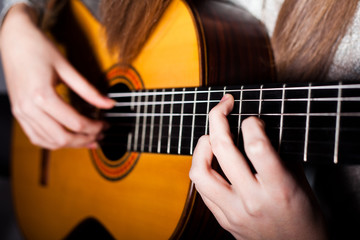 Woman playing accoustic guitar