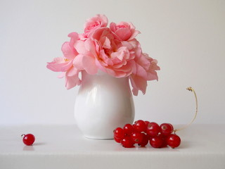 Bouquet of pink roses and red currants.
