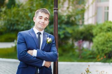 The groom leaned
