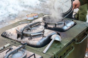 Cooking on a military field kitchen in field conditions
