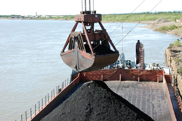 Slackline cableway bucket with coal at river port