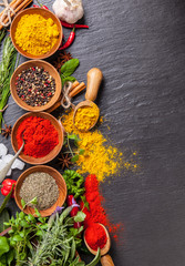 Wall Mural - Various spices on black stone