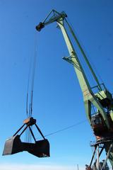 Dockside cargo crane with opened bucket