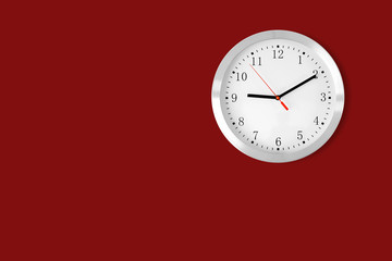 classic clock on red background with copy-space