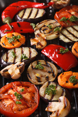 Background of grilled vegetables on the grill vertical top view